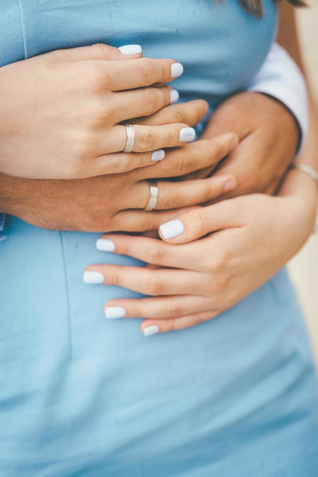 Couple embracing in blue photo