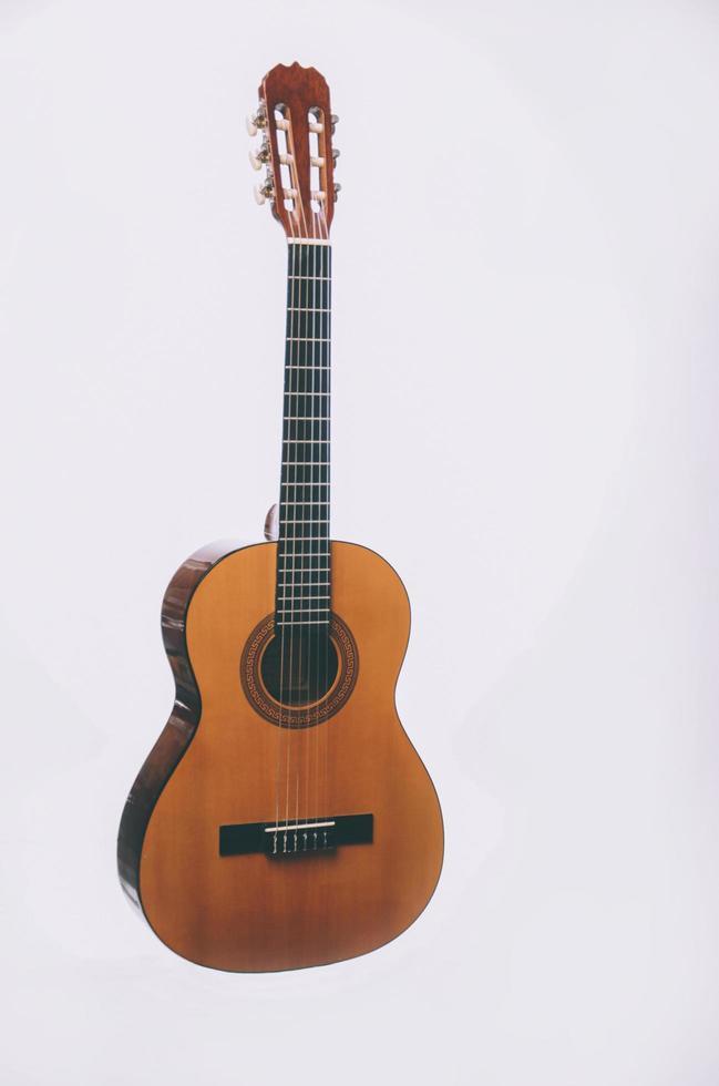 Guitar on white background photo