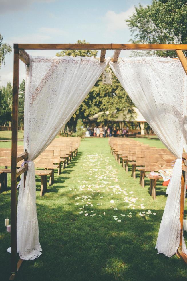 Outdoor wedding arch photo