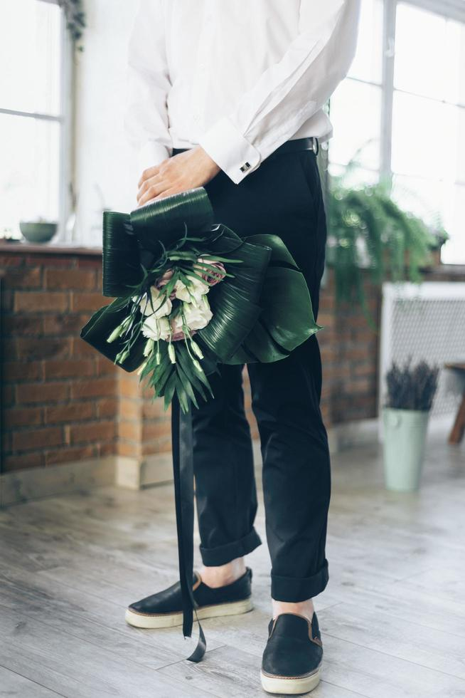 Groom holding a bouquet photo