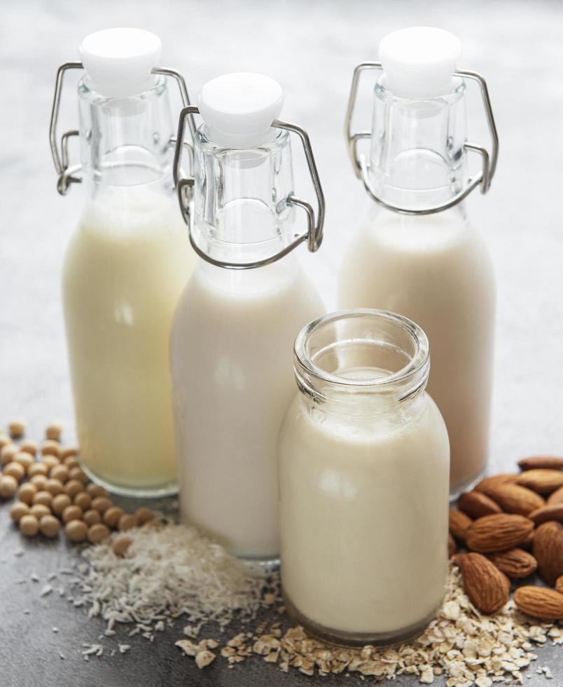 Bottles with different vegetable milk photo