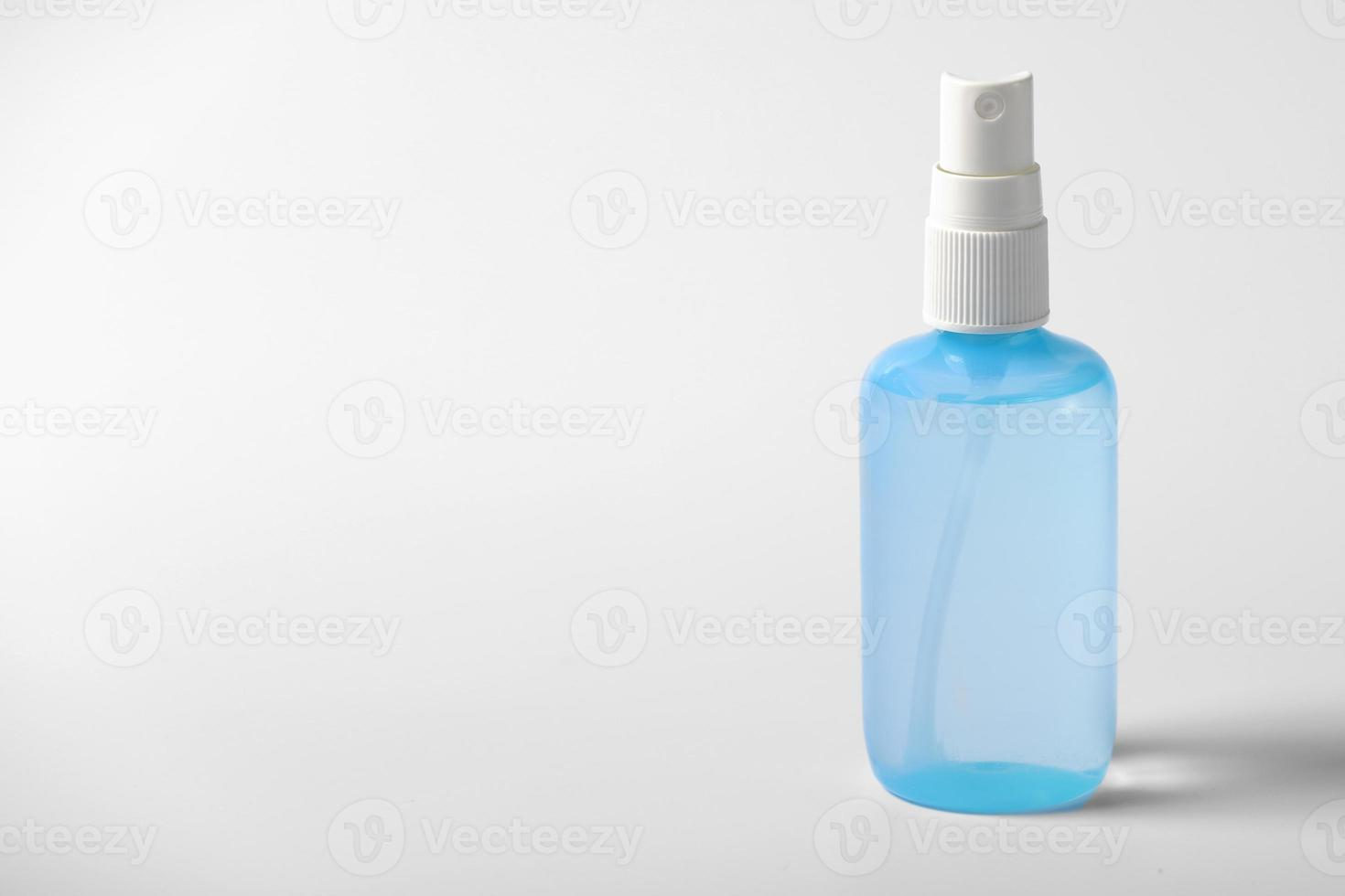 Clear hand sanitizer in a clear pump bottle isolated on a white background. Hand sanitizer is used for killing germs, bacteria and viruses photo