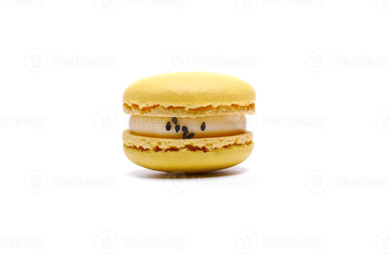 One cake of macaron or macaroon yellow lemon color. Delicious macaroon isolated on white background. French sweet cookie photo