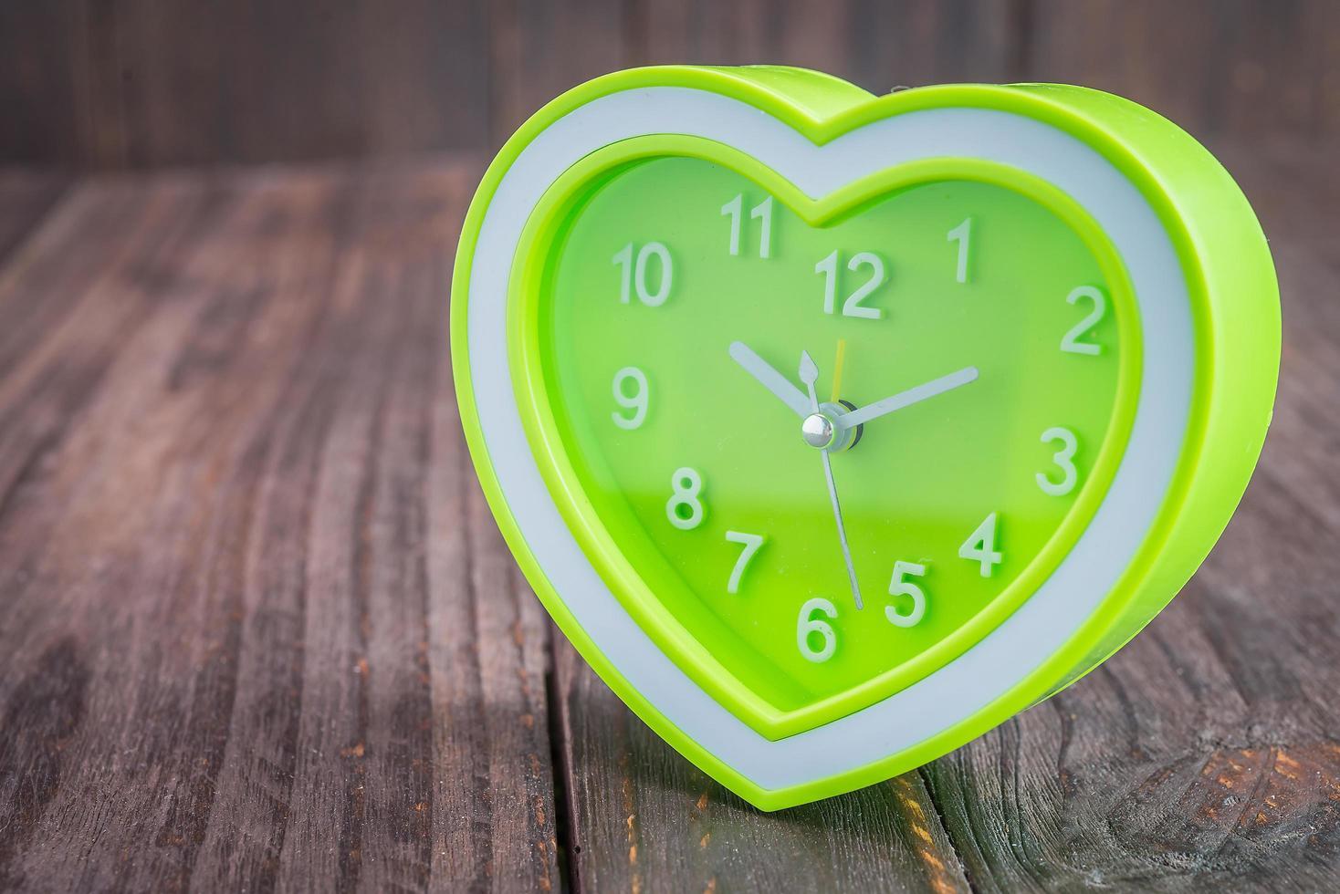 Clock on wood background photo