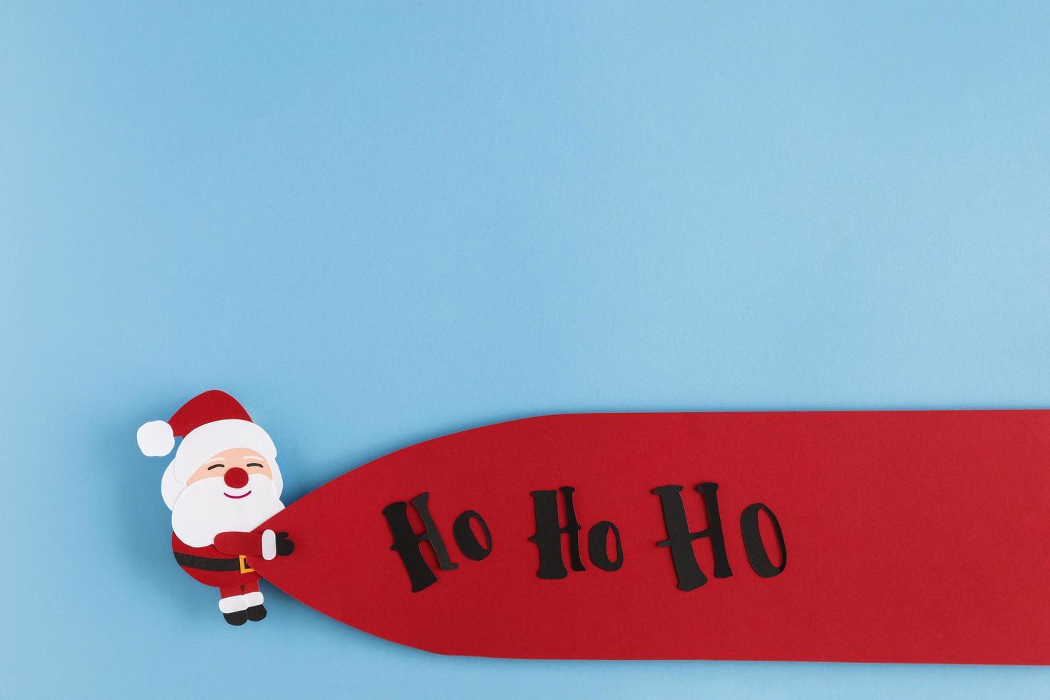 dibujos animados de santa sobre fondo azul para tarjeta de navidad foto