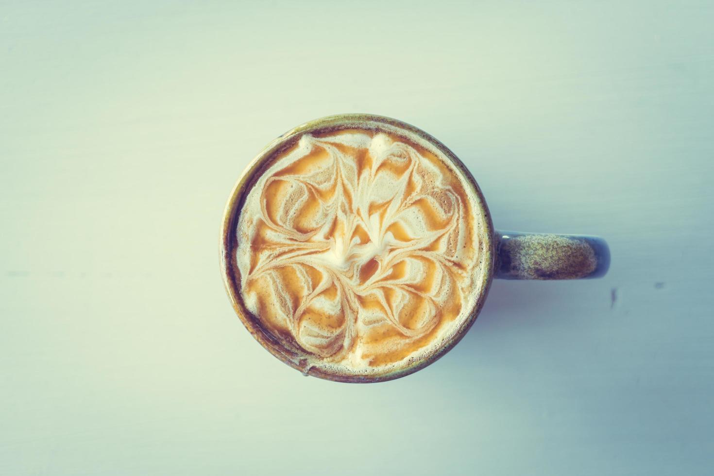 Hot latte caramel macchiato cup photo