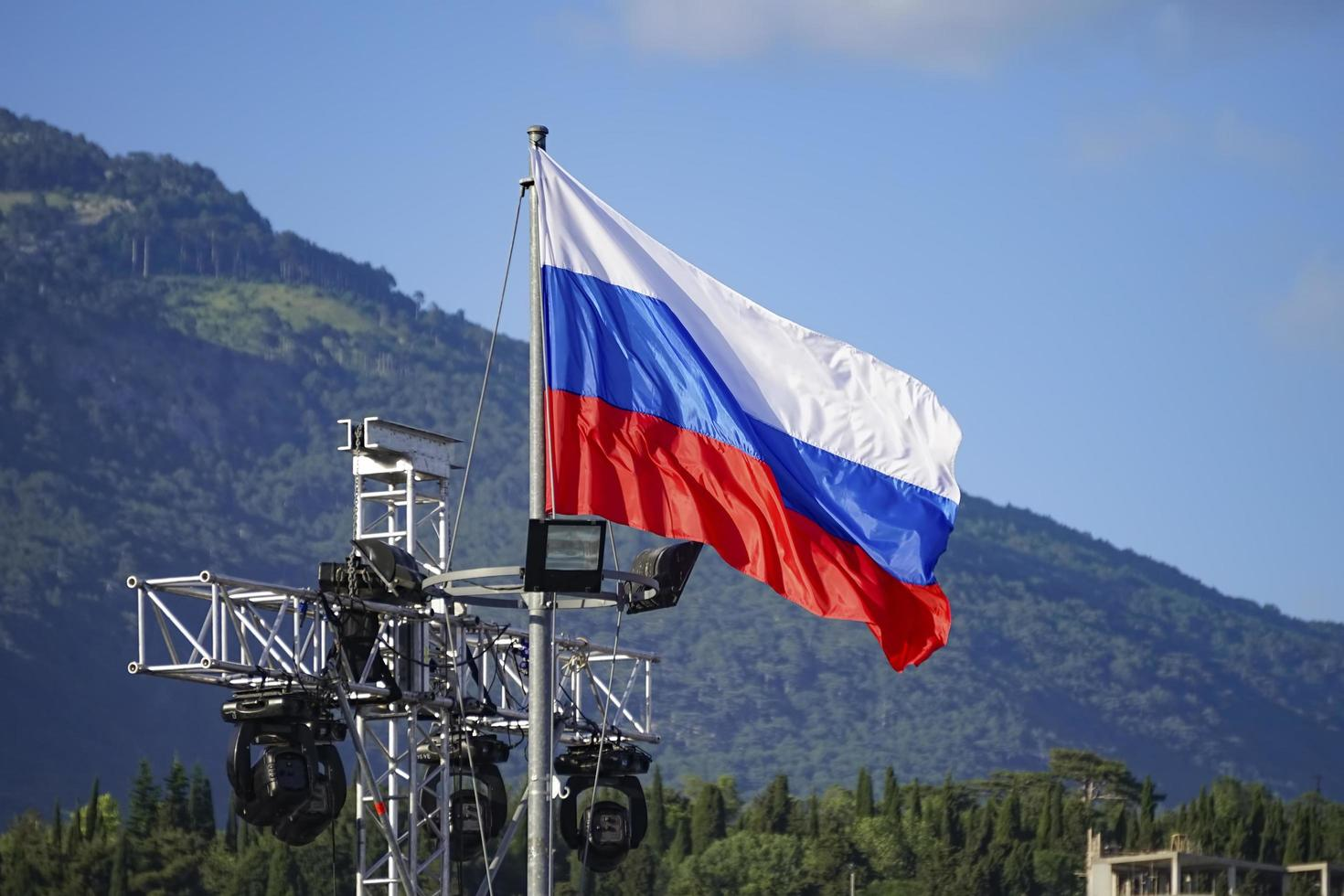 Russian flag with a background of mountains in Yalta, Crimea photo