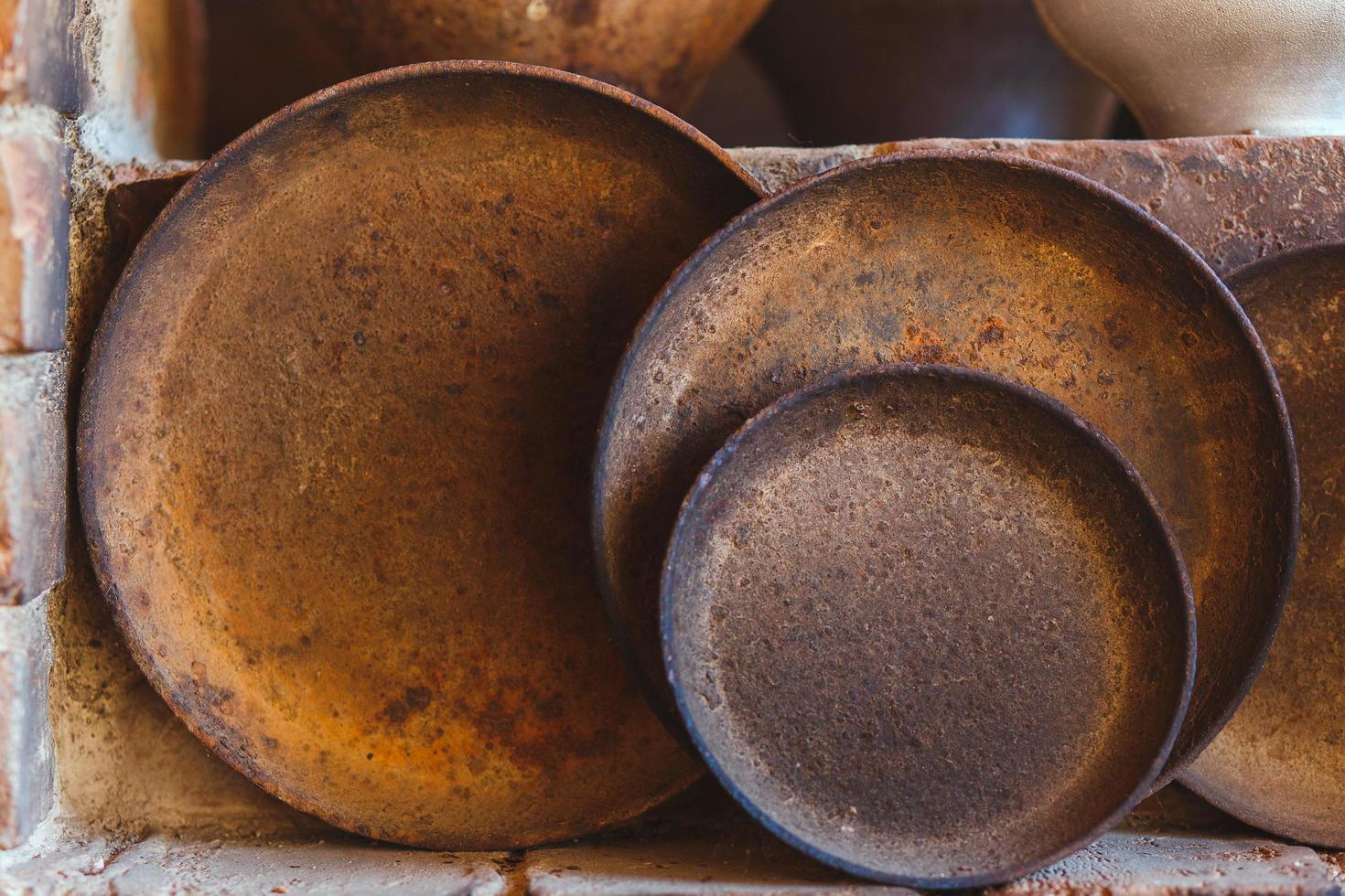 Close up of old pots and pans photo