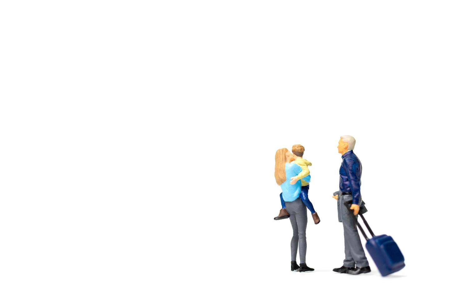 Miniature people, happy family standing on a white background and copy space for text photo