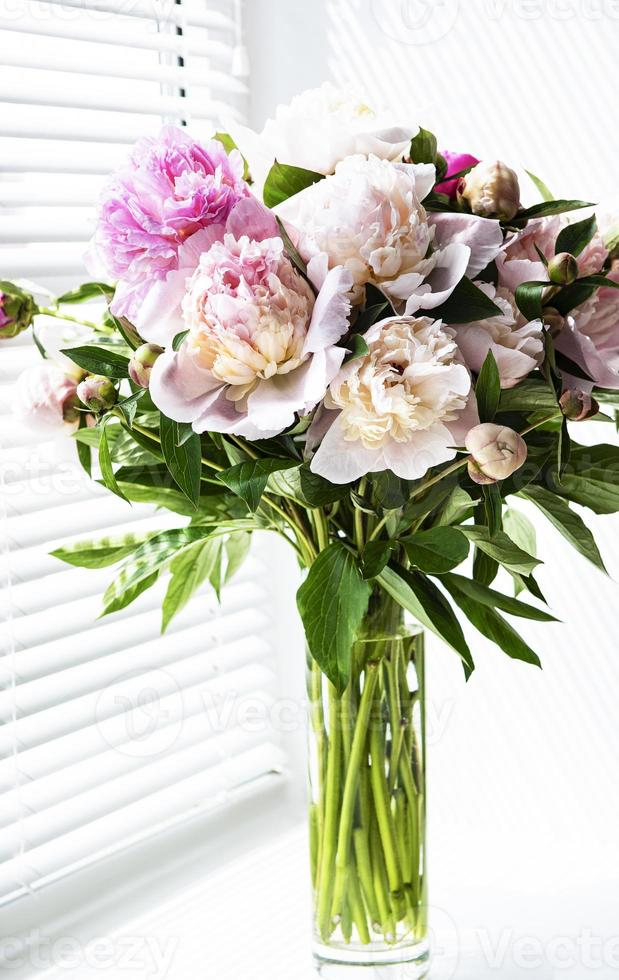 Beautiful peony bouquet in a vase photo
