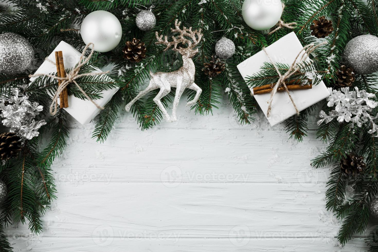 Christmas twig with silver deer present boxes photo