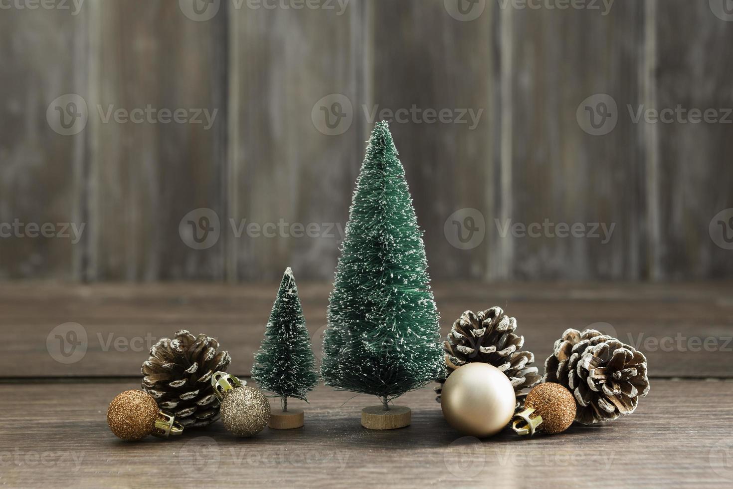 Arrangement with Christmas trees pine cones photo