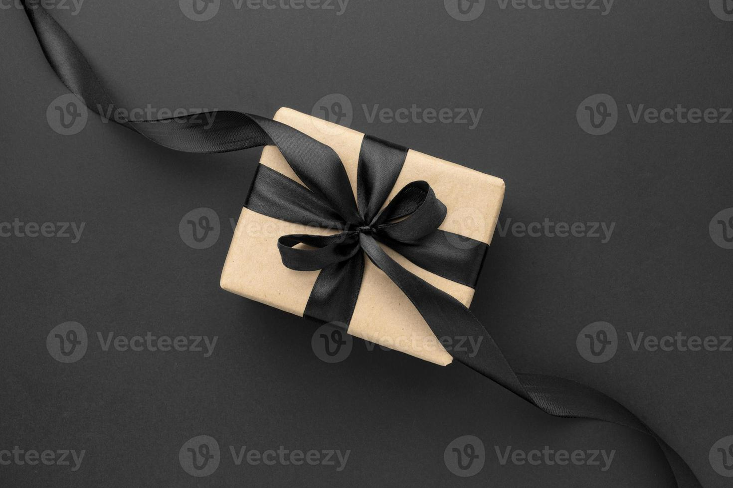 Flat lay black friday sales assortment with gift on black background photo