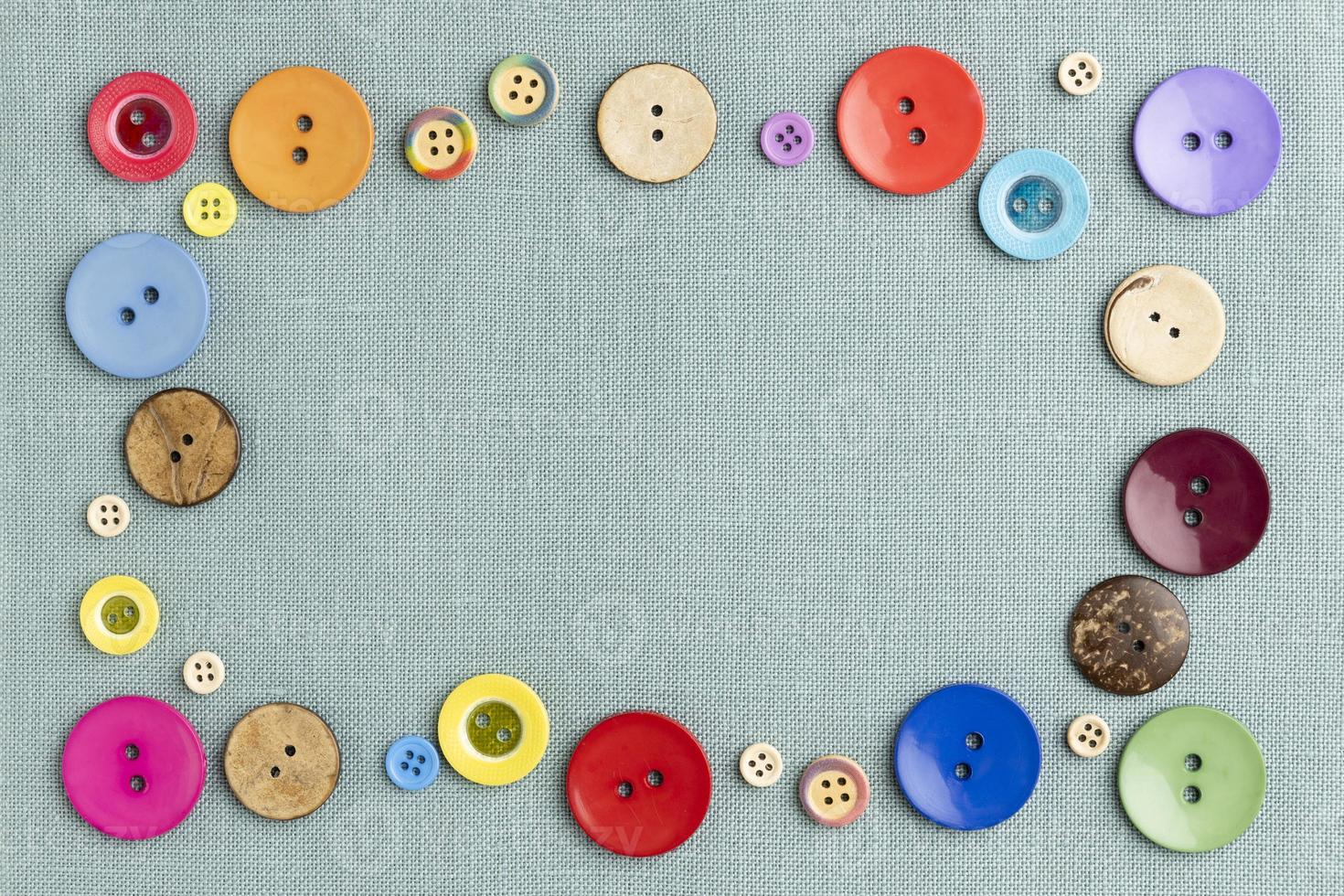 Flat lay colorful buttons on cloth photo