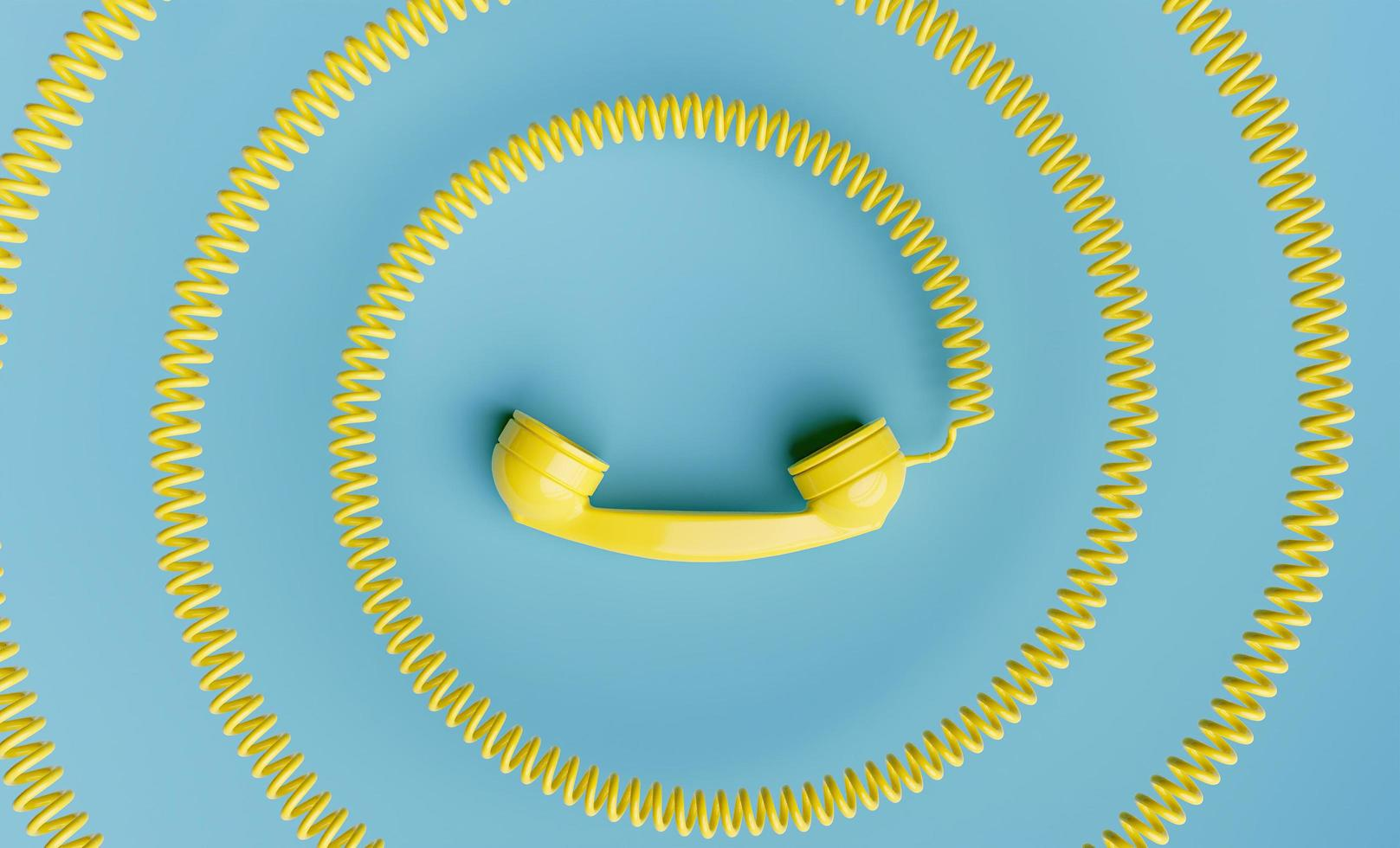 Telephone handset with coiled cord towards the center of the image photo