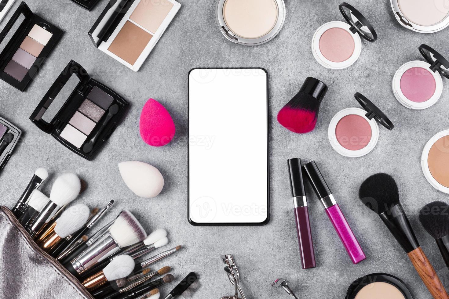 Top view makeup desk concept with copy space photo
