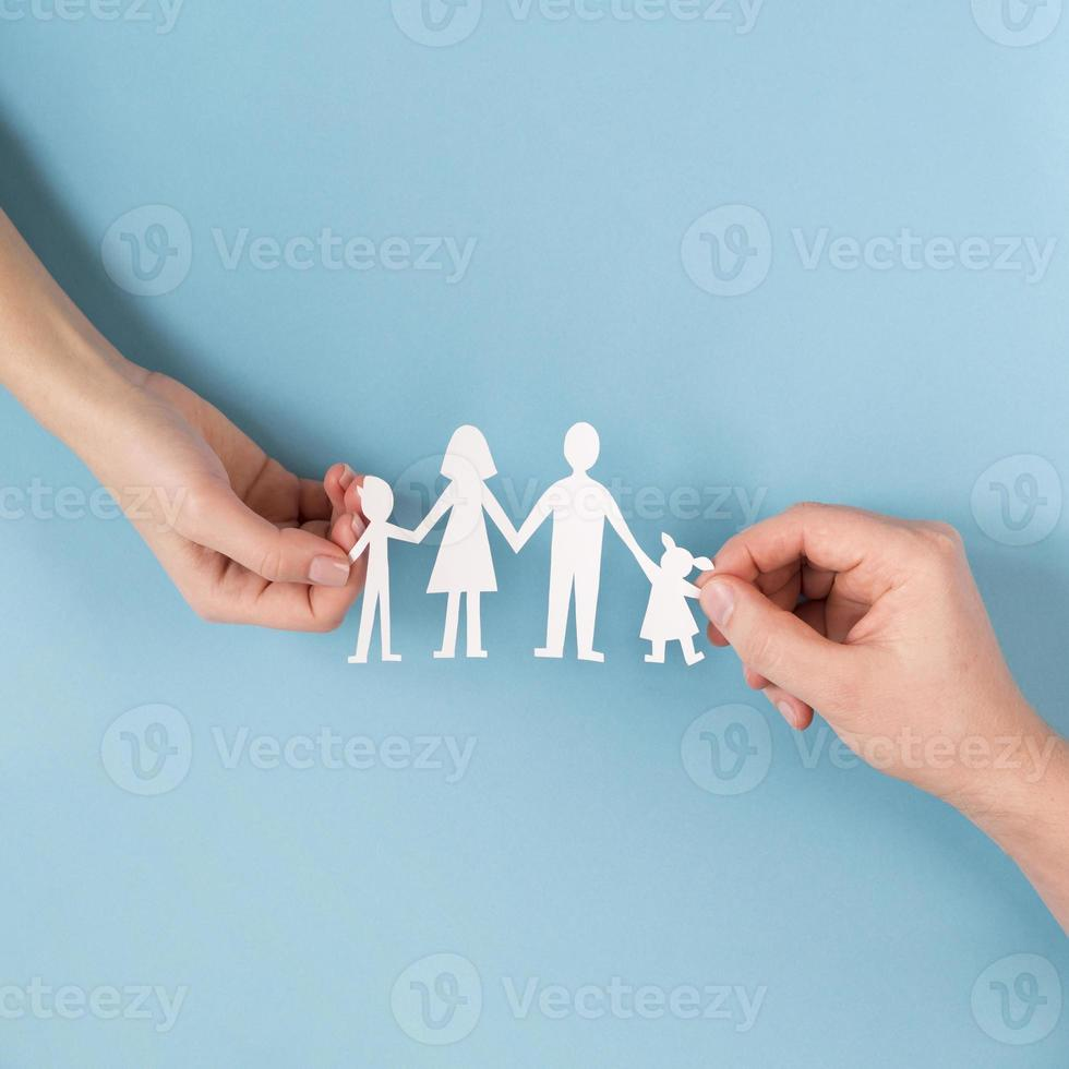 Top view people holding hands with cute paper family photo