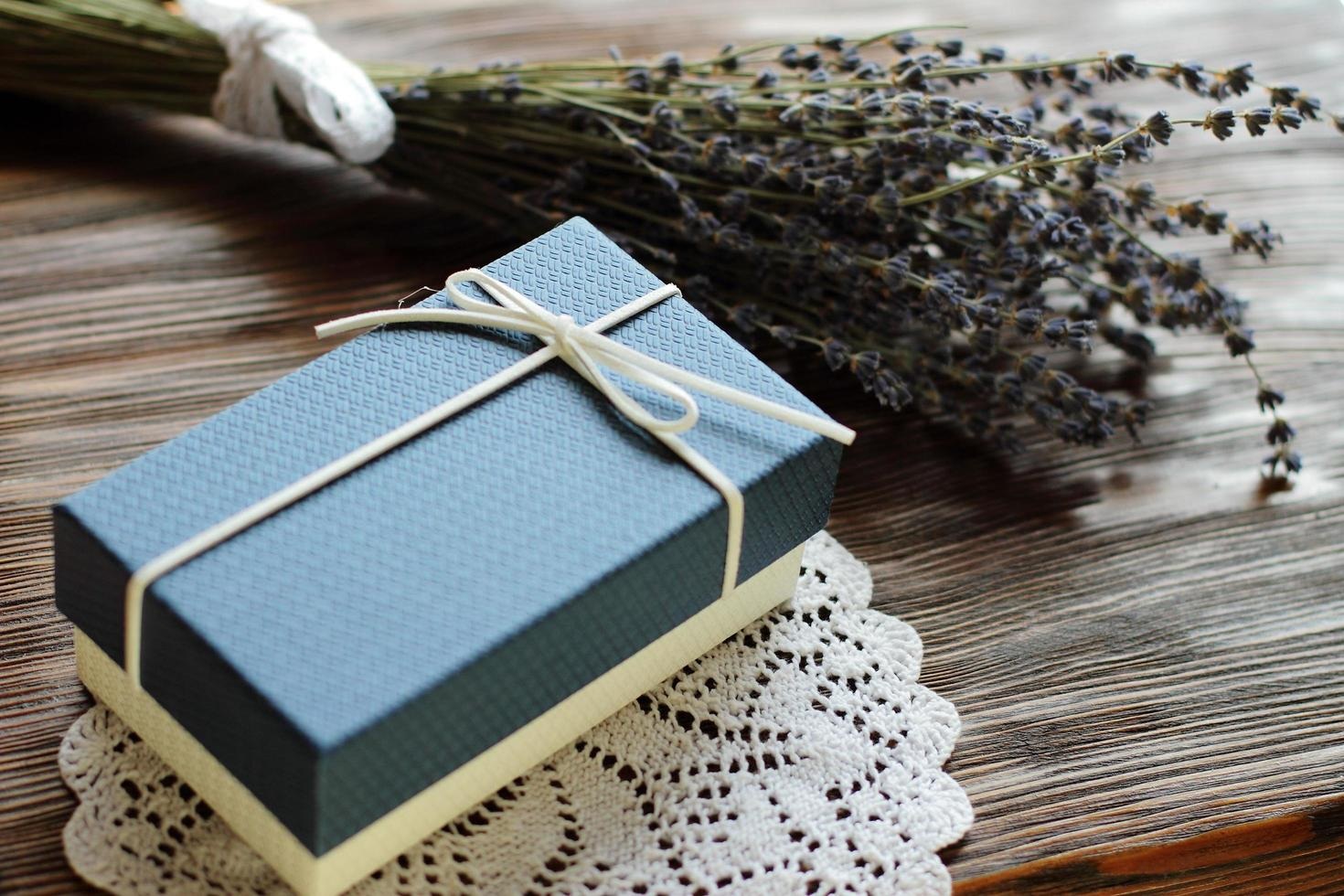 Blue present box with lavender flowers photo