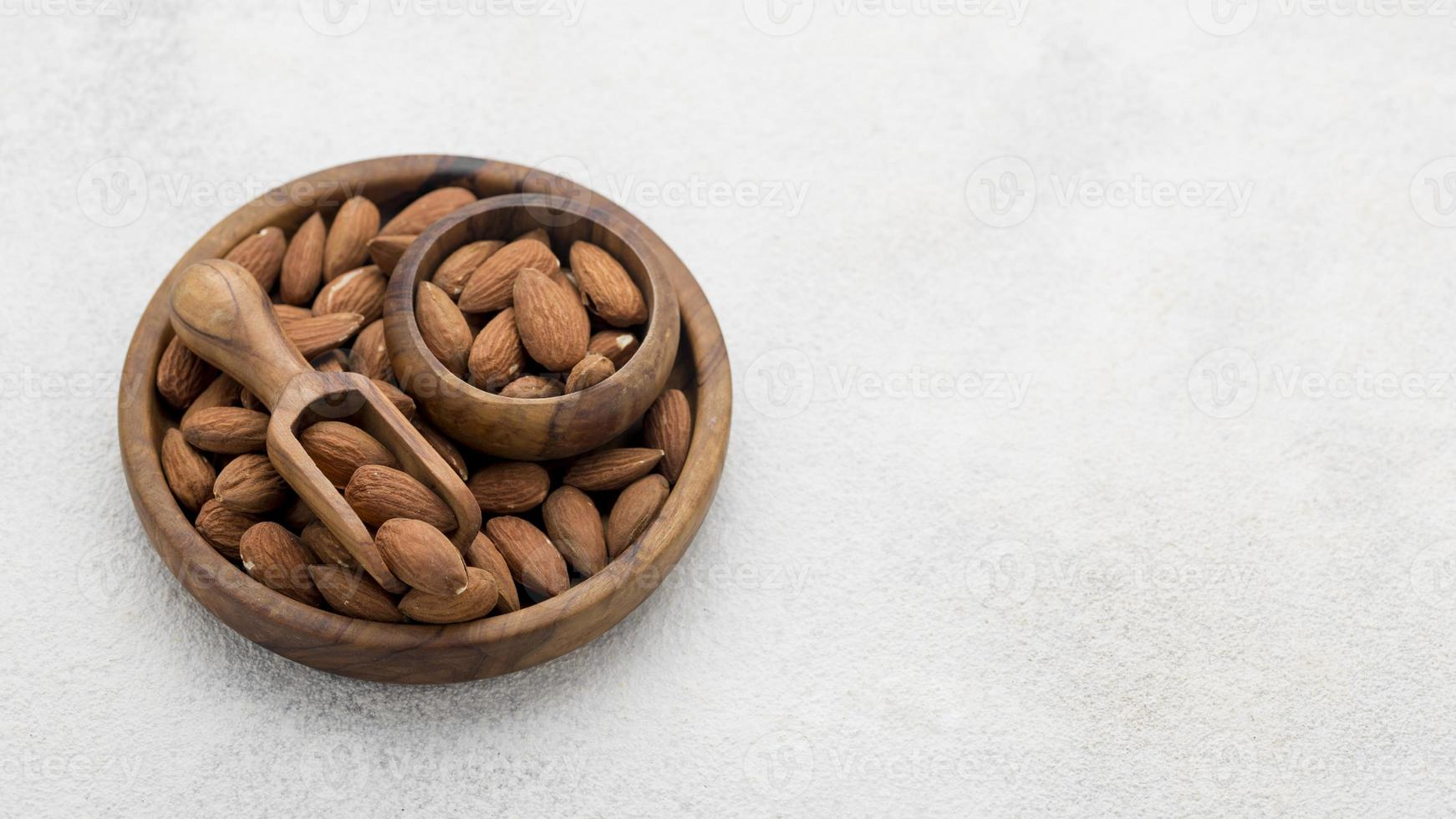 Organic almond nuts bowl with copy space photo