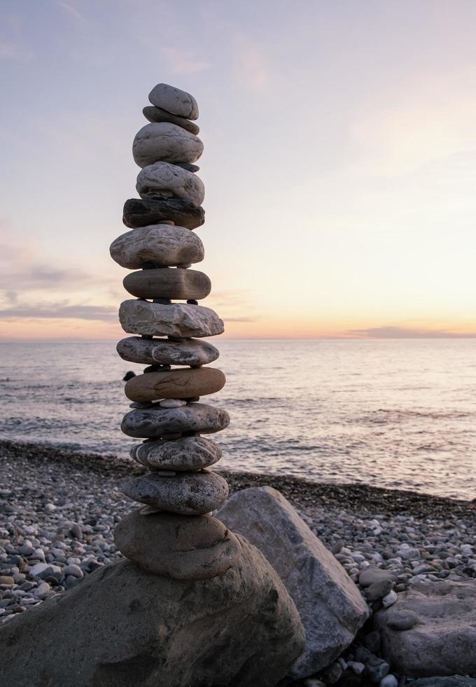Arrangement with pebbles at seaside photo