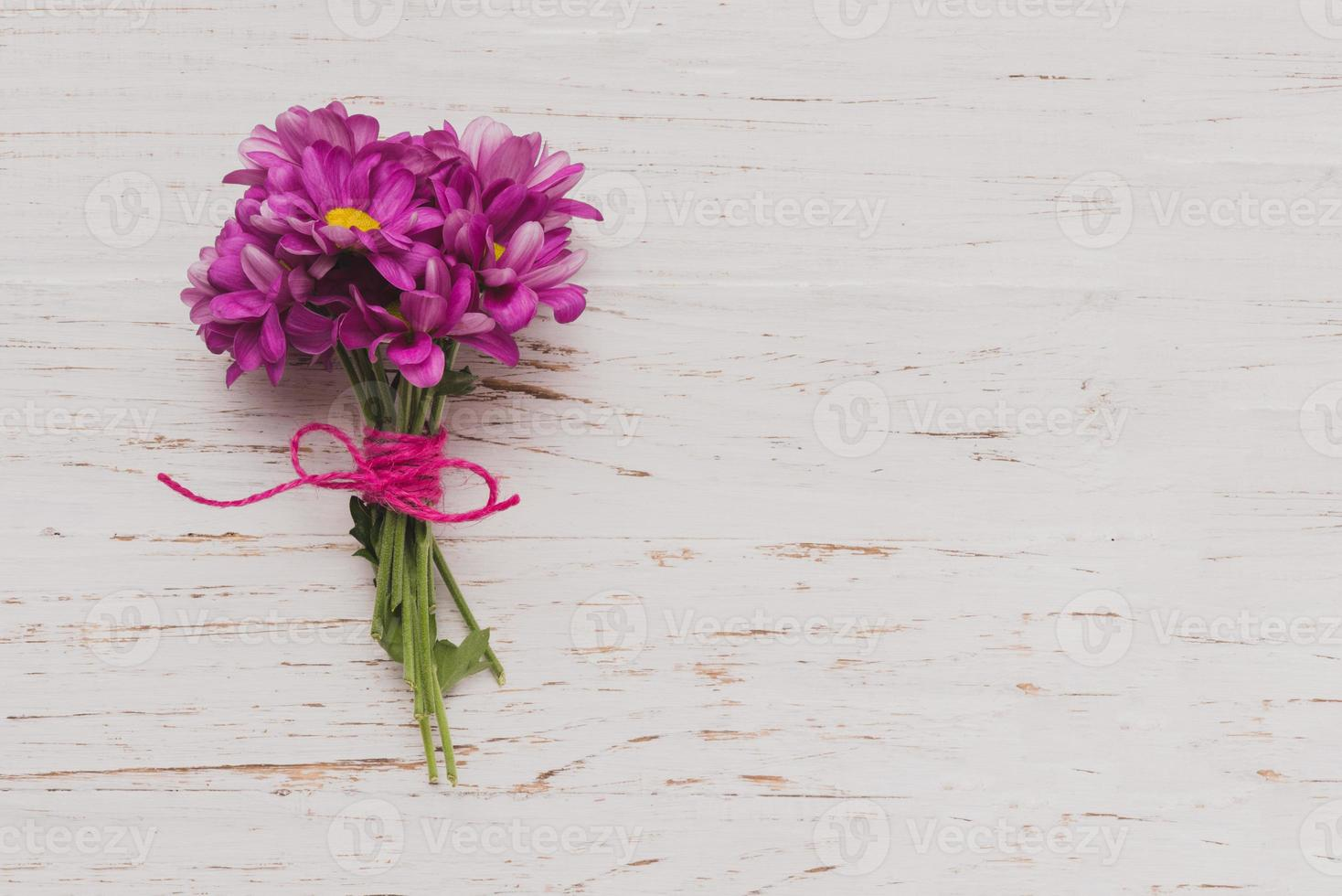 purple flowers tied white wooden surface. High quality and resolution beautiful photo concept