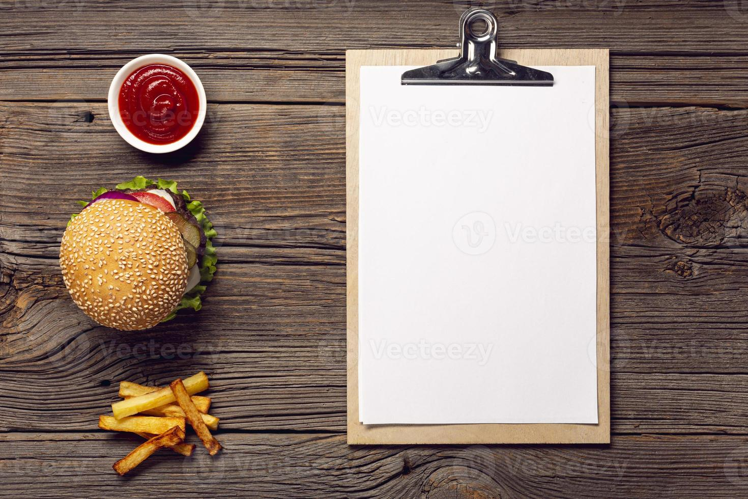 Top view burger with mock up clipboard photo