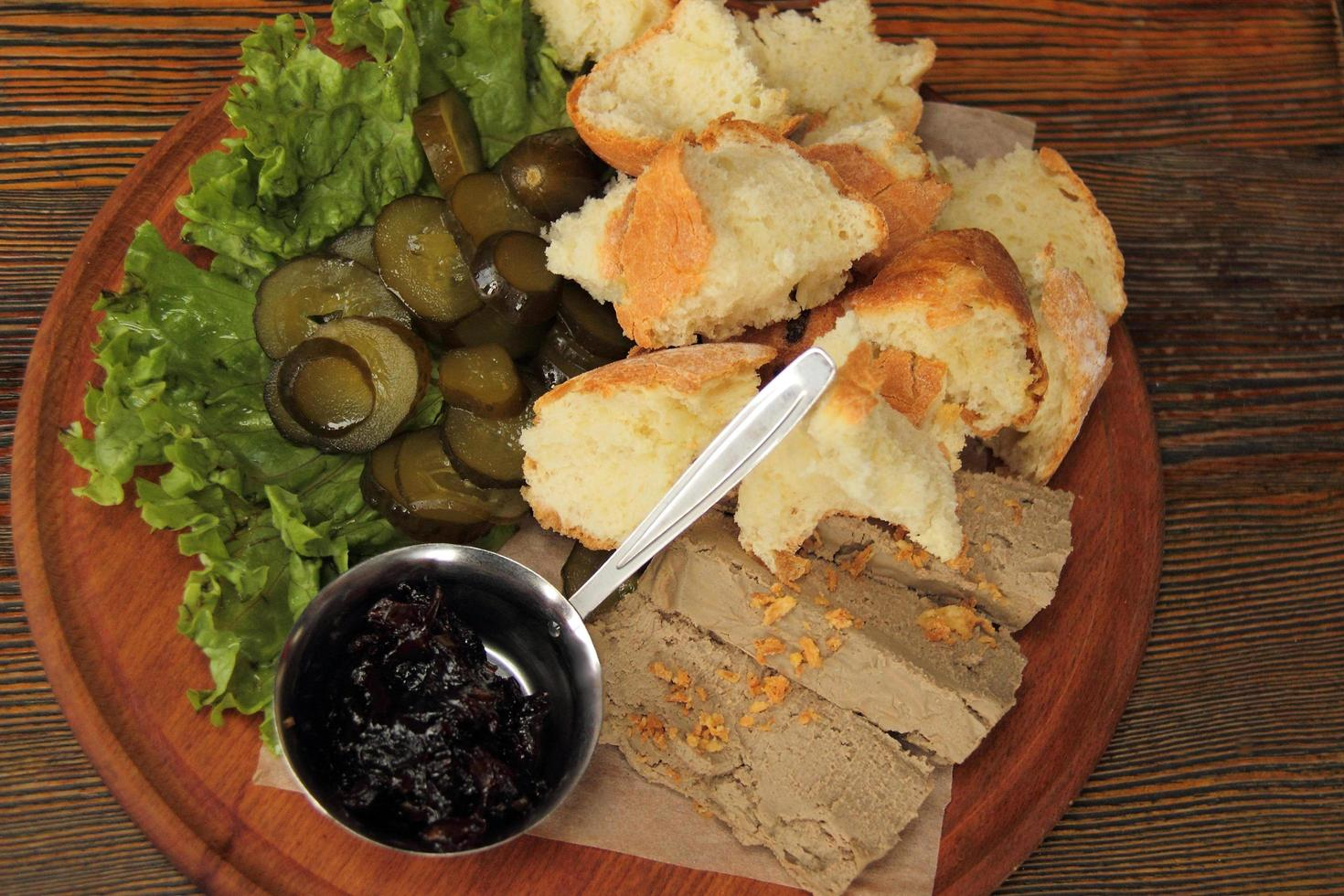Top view of pate with bread and pickles photo