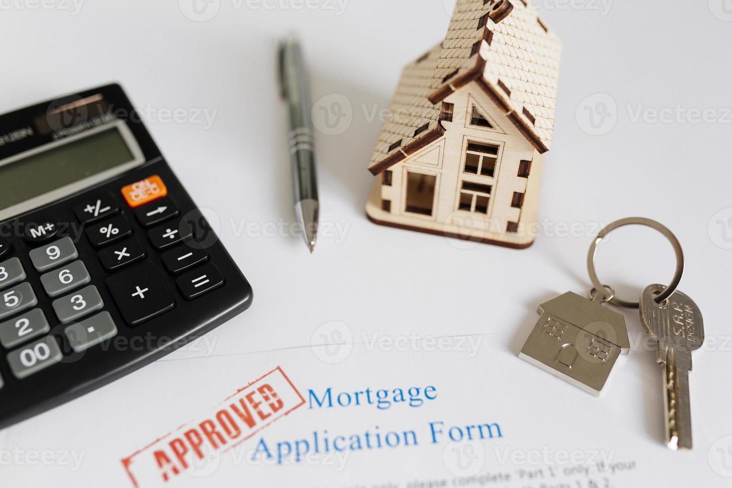 Mortgage contract and house figurine photo