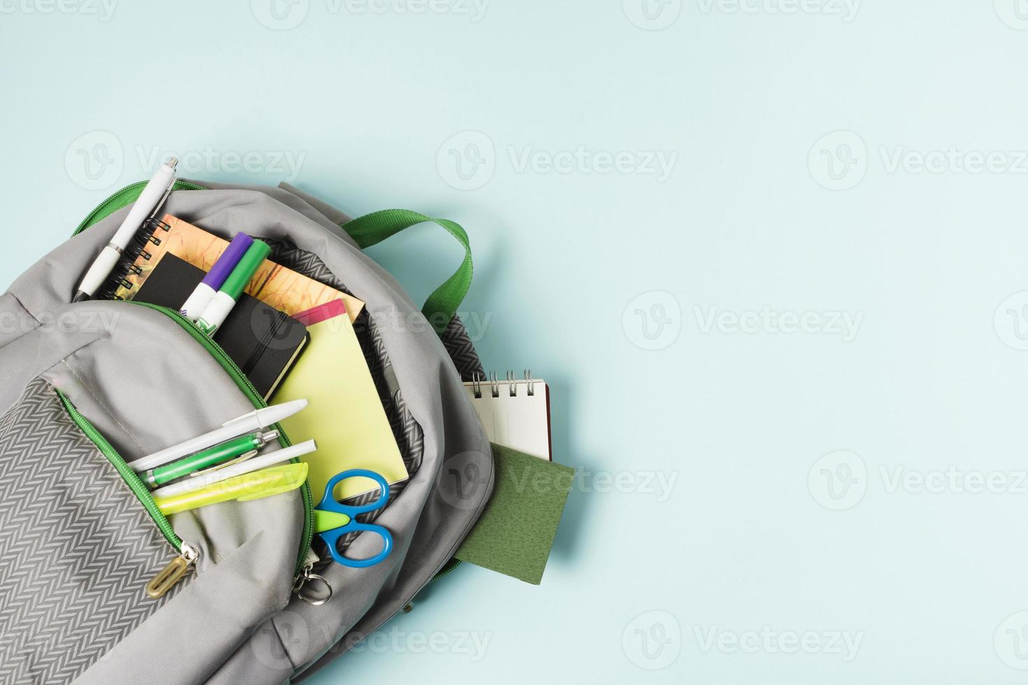 Opened backpack with school supplies photo