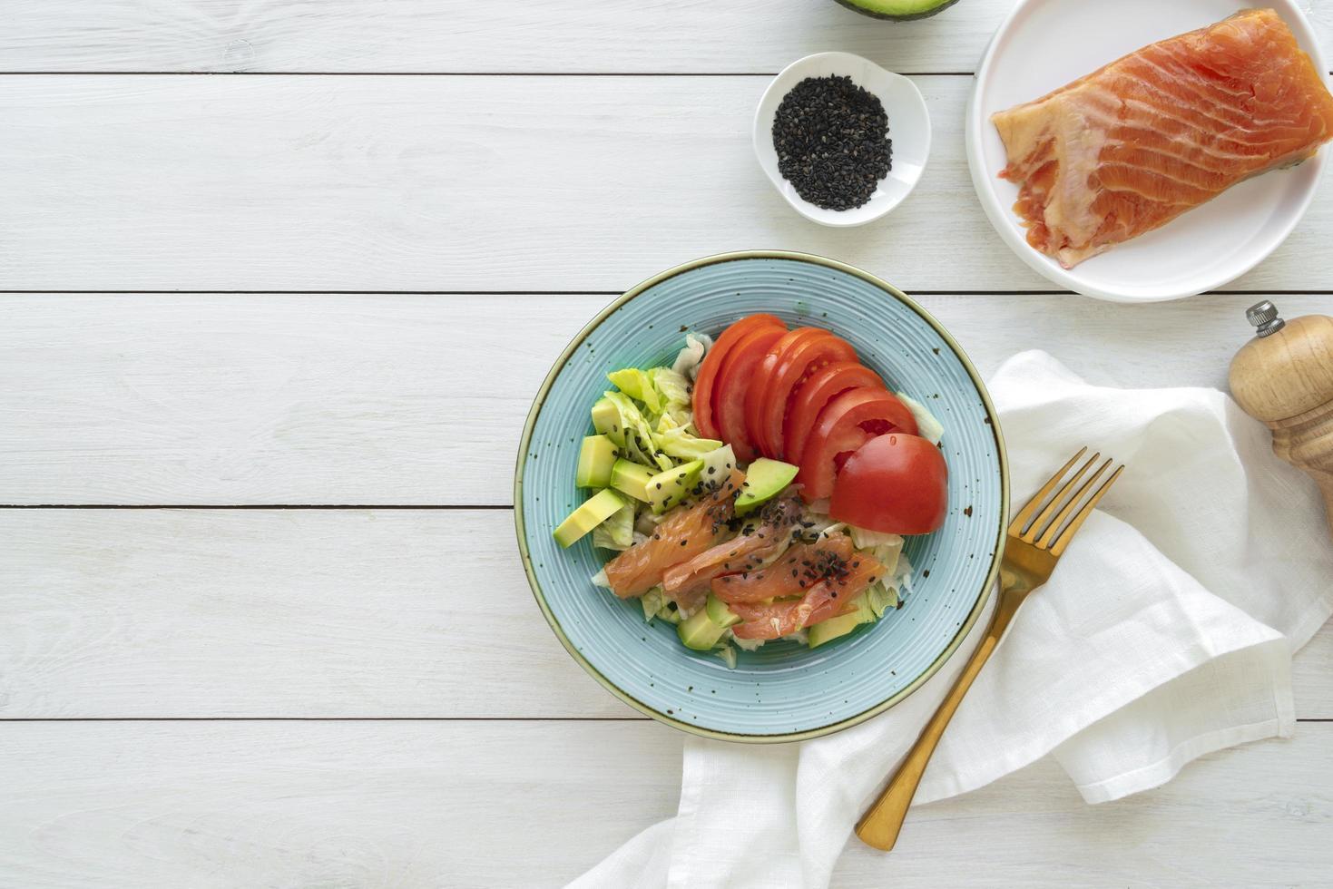 Salmon filet with avocado salad photo