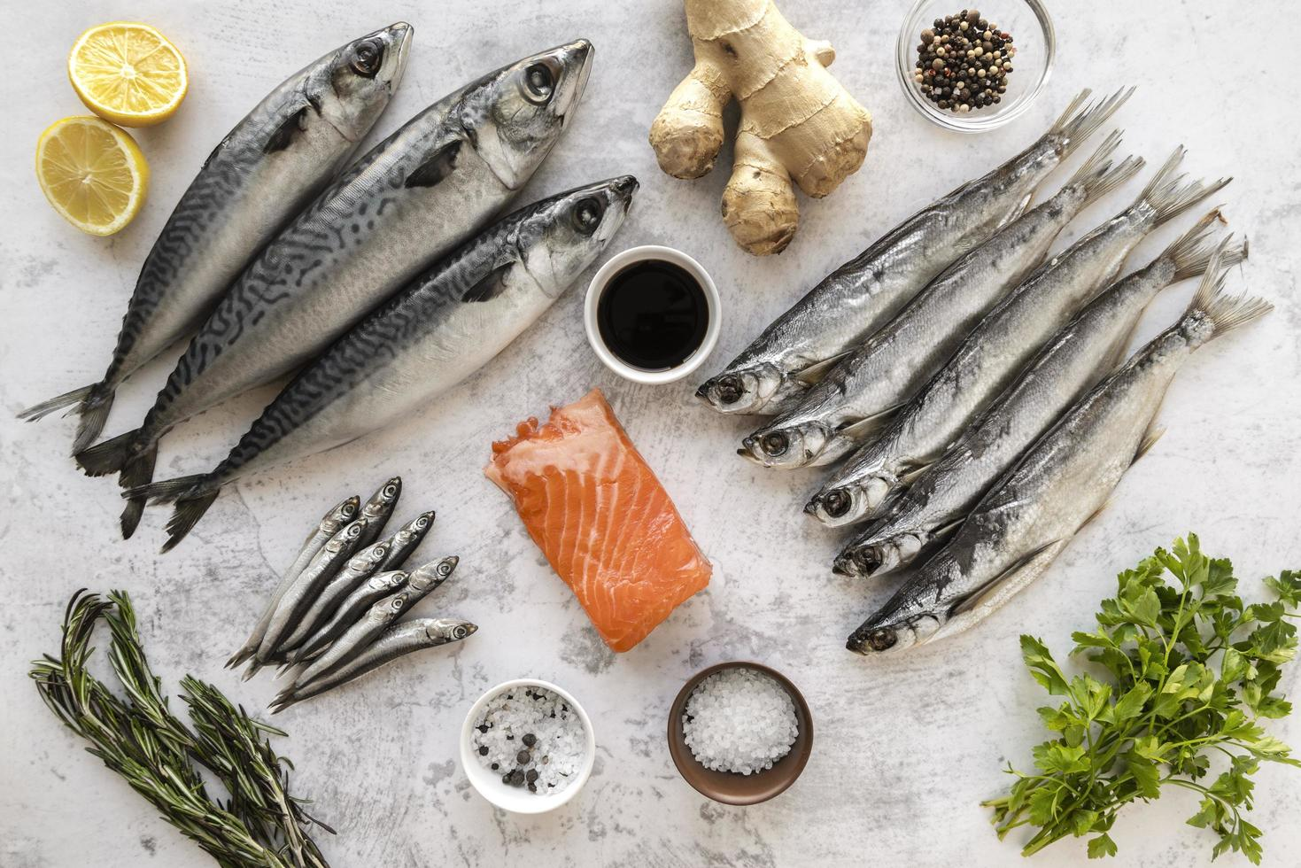 Fresh whole fish with ingredients photo