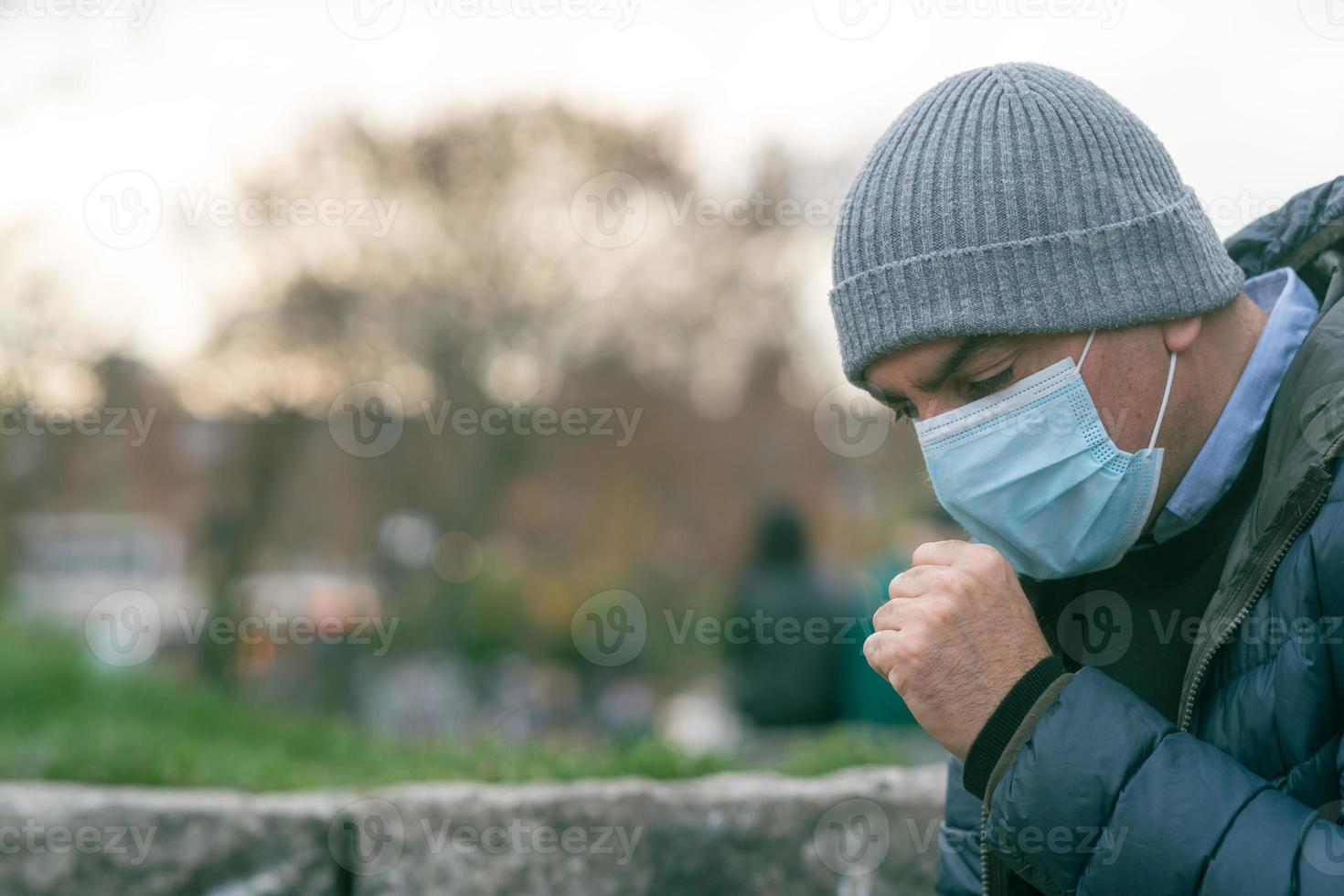 Sneezing using a protective mask photo