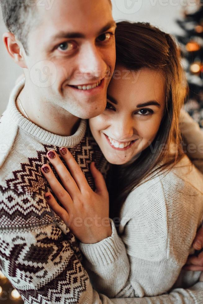 guy and a girl celebrate the new year together and give each other gifts photo