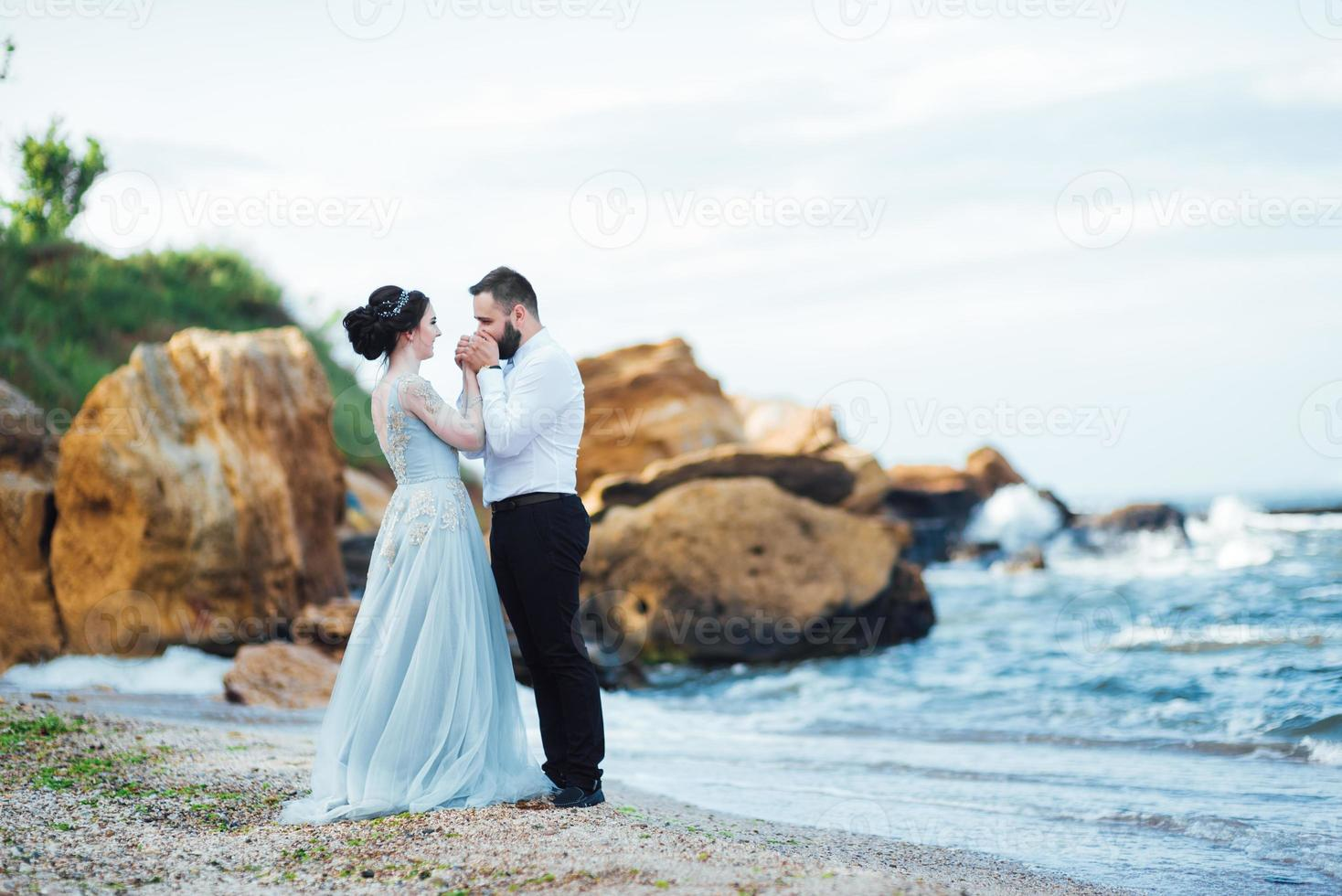 same couple with a bride in a blue dress walk photo