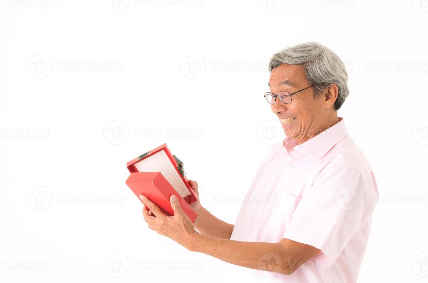 Senior Asian man with gift box, isolated photo