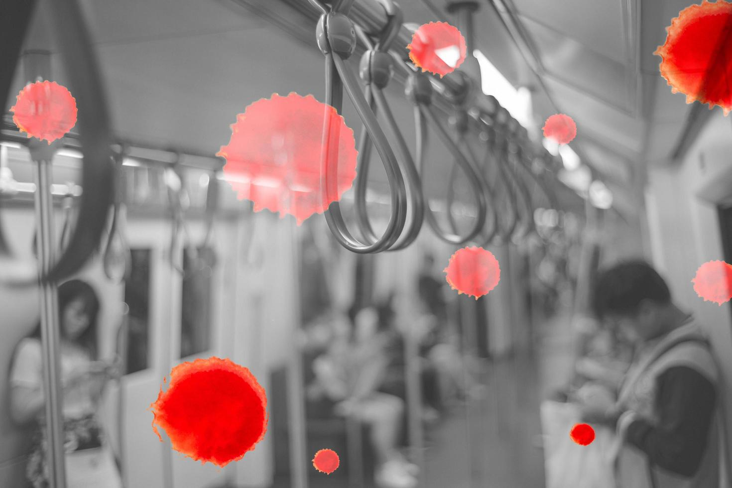 Selective focus on group of handrails inside the train with blurred passengers and bokeh lights in background photo