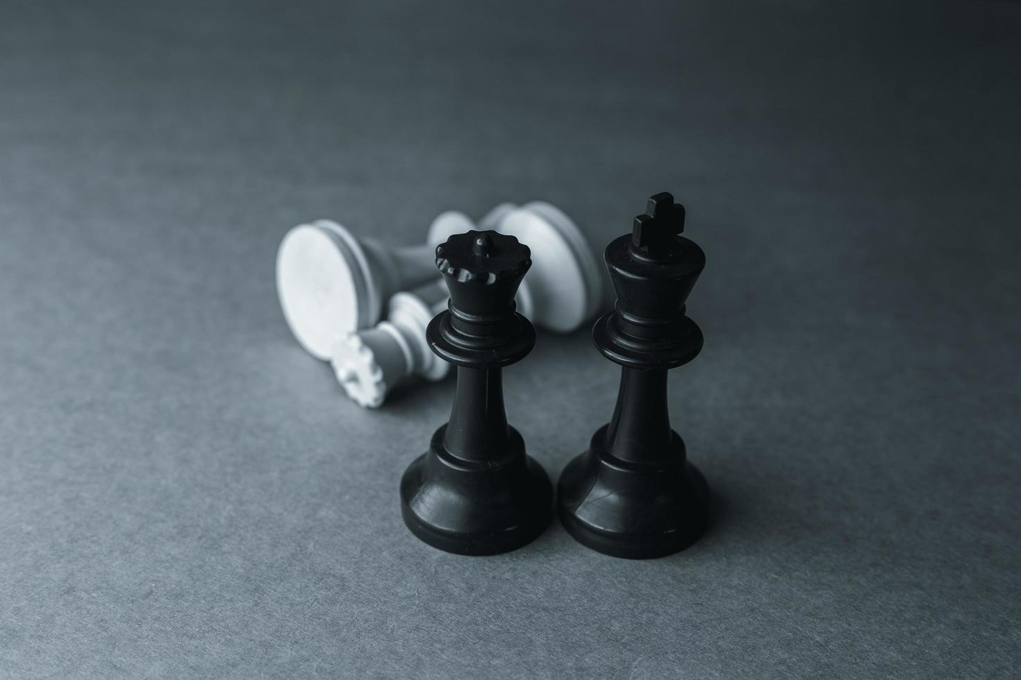 Chess pieces, supremacy of the black pieces photo