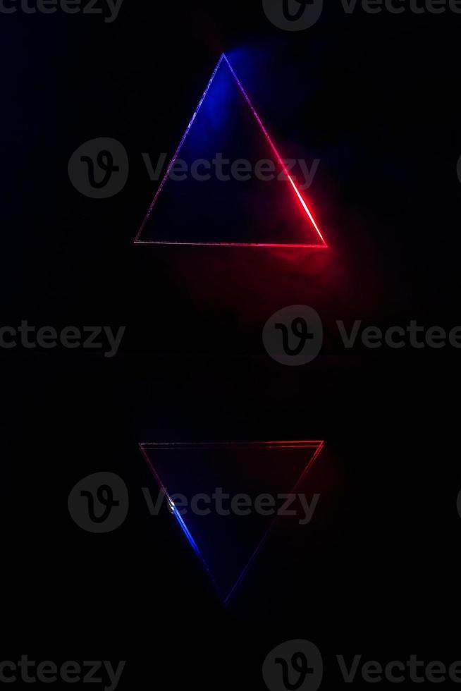 Lighting and smoke through the triangle and reflective. photo