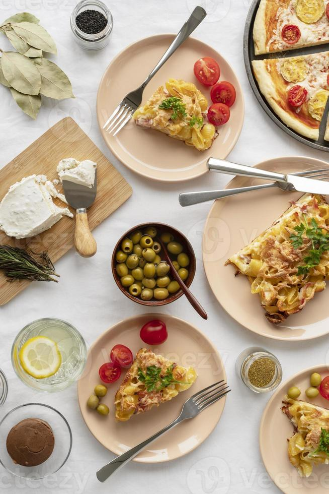 Olives and other foods on brunch table photo