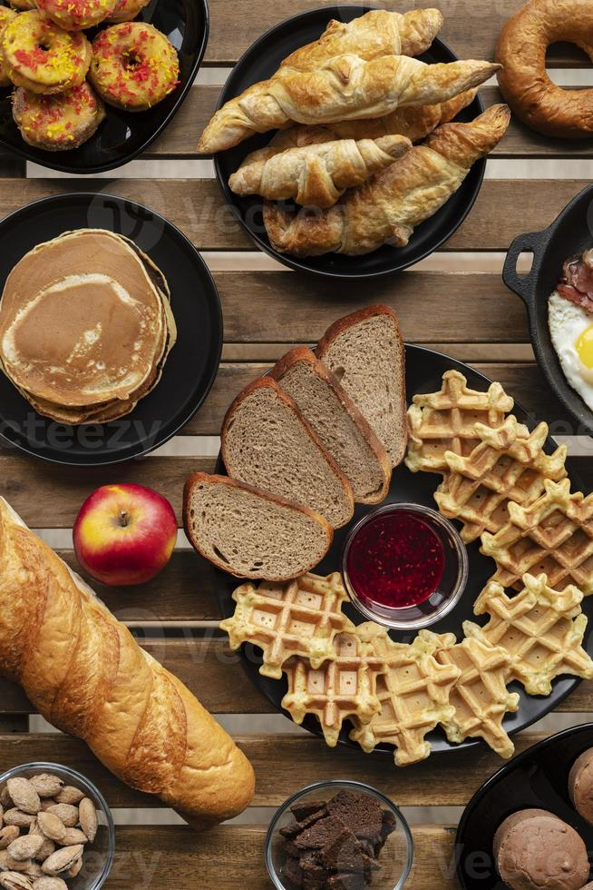 Breakfast waffles and croissants top view photo