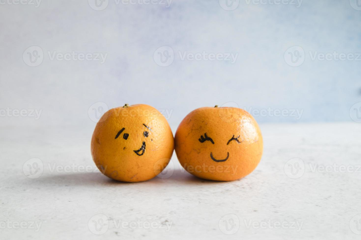Tangerines with funny faces photo