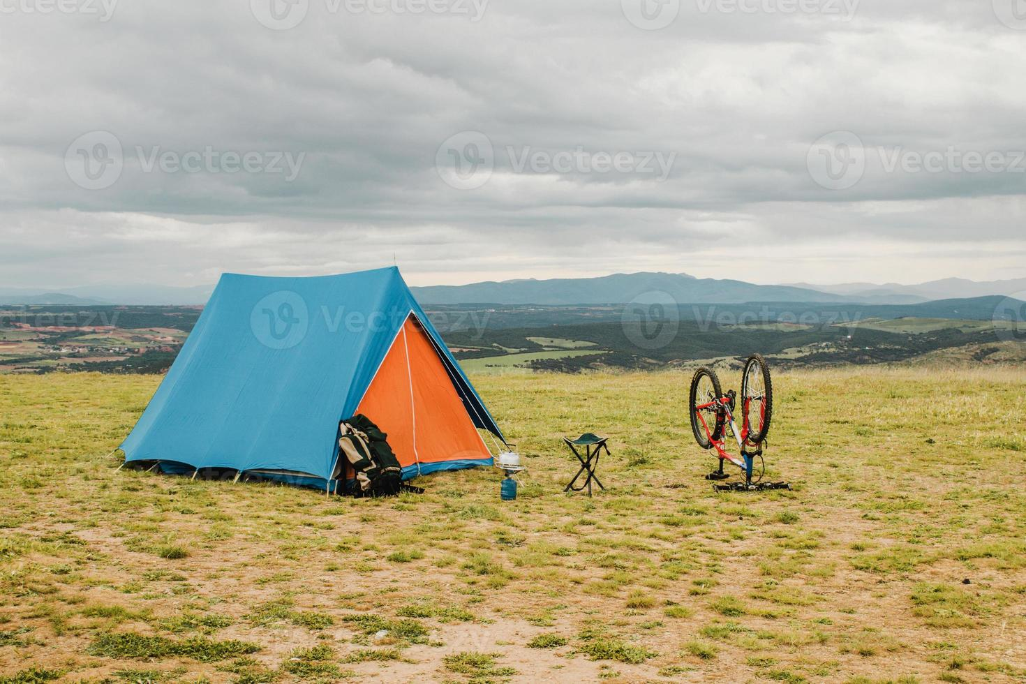 Tent and bike in the countryside photo