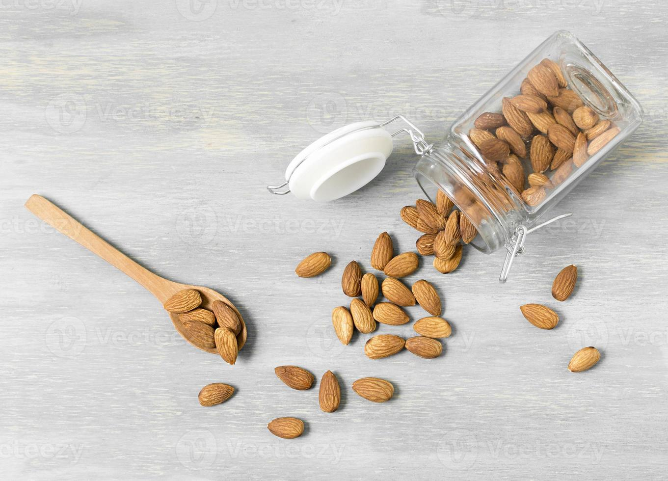 Top view almonds jar with spoons photo