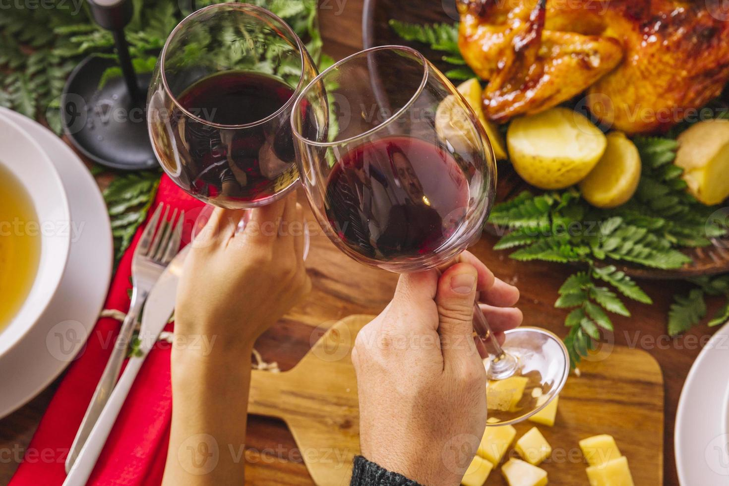Toasting with two glasses of wine photo