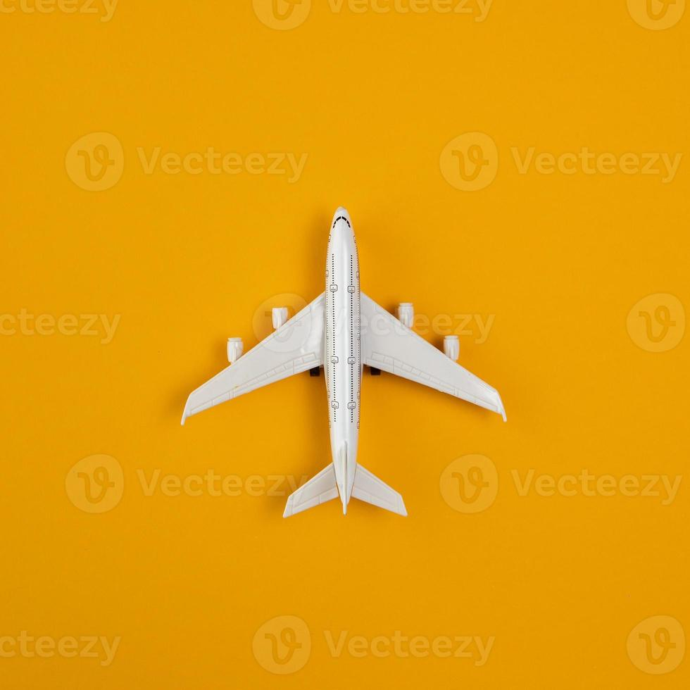 Top view airplane with copy space on orange background photo