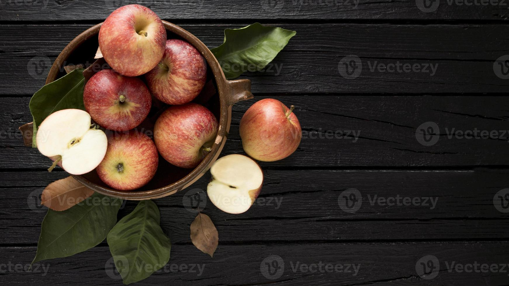 Top view apples in a basket with copy space photo