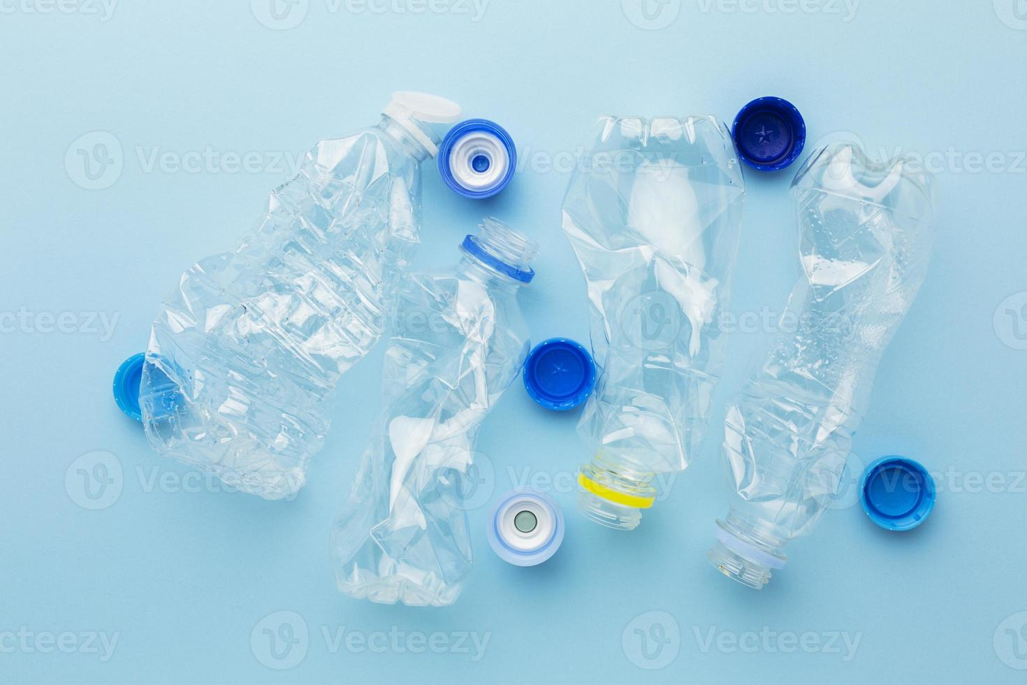 Top view bottles and caps of plastic waste photo