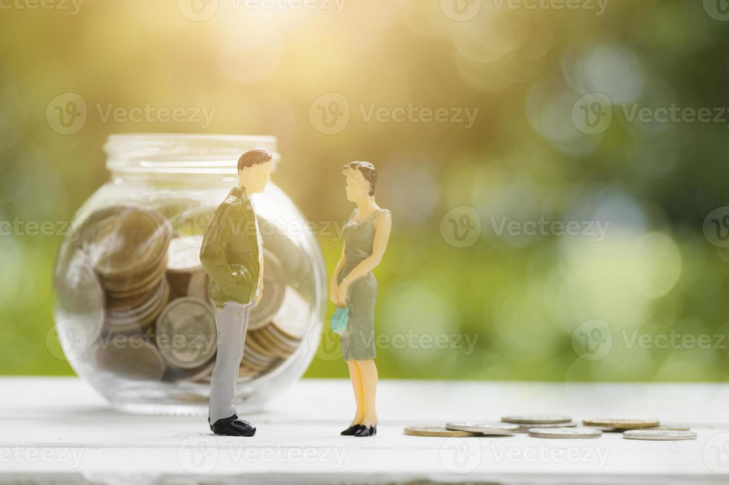 Two figurines with money photo