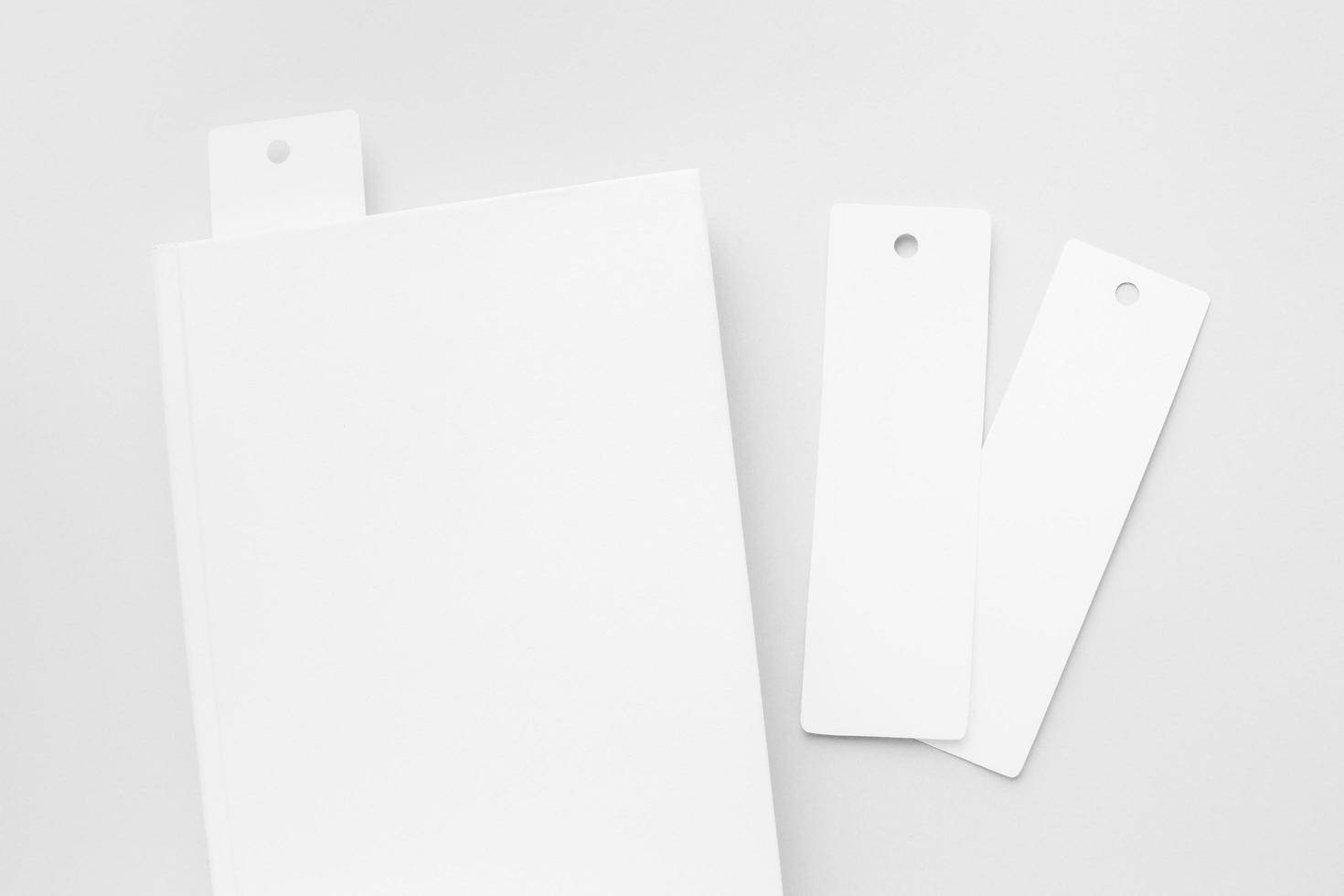 Top view book with bookmarks on white desk photo