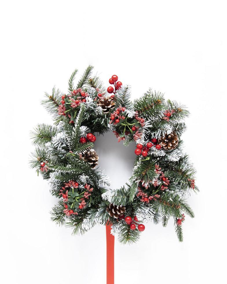 Snowy festive wreath on white background photo